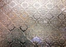 Färgrikt suddighetsexponeringsglas av guld- fönsterbakgrund royaltyfria foton