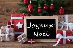 Färgrikt träd, Joyeux Noel Means Merry Christmas Arkivfoto