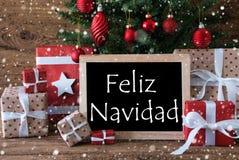 Färgrikt träd med snöflingor, Feliz Navidad Means Merry Christmas Arkivfoto
