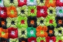 Färgrikt tyg för kullestamtextil Arkivbild