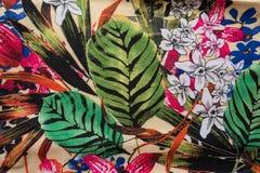 Färgrikt tyg med det blom- trycket Arkivbild