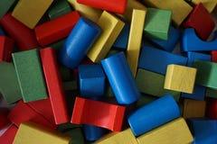 Färgrikt woodden tegelstenar för att spela Arkivbild