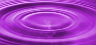 Färgstänk av bevattnar Bevattna tappar Foto av droppe av en droppe i vatten Arkivfoton