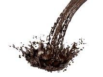 Färgstänk av choklad som isoleras på vit bakgrund Fotografering för Bildbyråer