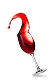 Färgstänk av rött vin i exponeringsglas Royaltyfri Foto