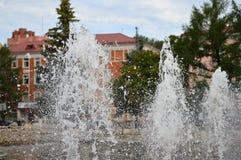 Färgstänk av vatten i springbrunn Arkivbild