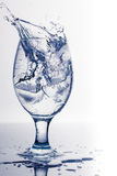 Färgstänk från iskuben Arkivbild