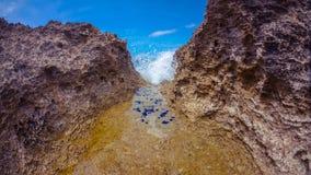 Färgstänk in i grottan Arkivfoton