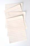 fästande ihop fodrade paper banor för anteckningsbok royaltyfri fotografi