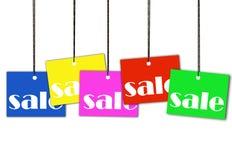 fästande ihop hängande banaförsäljningsetiketter Arkivfoto
