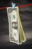 Fäste ihop dollarräkningar Arkivfoto