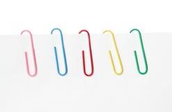 fäster färgrikt papper ihop Arkivfoton