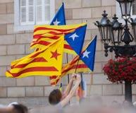 Få som flyger Catalonia flaggor Royaltyfria Bilder