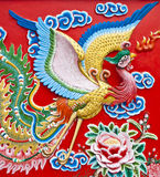 fågeln skulpterar väggen Royaltyfri Foto