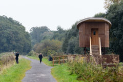Fågelskinn och fotograf på Shapwick Heath National Nature Res arkivfoto