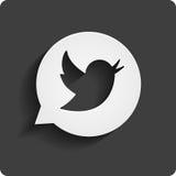 Fågelsymbol med anförandebubblan som isoleras på svart bakgrund Fotografering för Bildbyråer