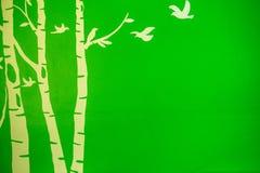 Fågelträd i grön bakgrund Fotografering för Bildbyråer