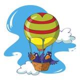 Fåglar som flyger i en ballong Arkivfoton