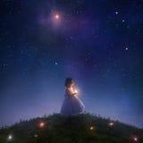 Fånga fallande stjärnor arkivbilder