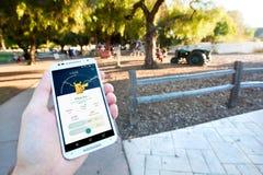 Fångade Pikachu i Pokemon GÅR Fotografering för Bildbyråer