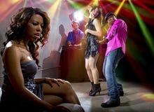Fångat fusk på en nattklubb royaltyfri foto