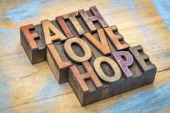 Fé, amor e esperança no tipo de madeira fotografia de stock royalty free