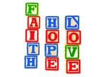 A fé, esperança, letra de amor obstrui o vertical 2 Imagens de Stock