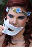 Fée derrière le masque Images stock