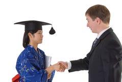 Félicitation à recevoir un diplôme Photo stock