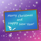 Félicitations de Noël sur un tableau noir dans a  Images stock