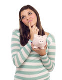 Fêmea étnica que Daydreaming ao prender o banco Piggy Fotos de Stock Royalty Free