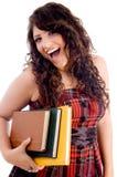 Fêmea alegre com livros Imagens de Stock