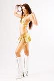 Fêmea da dança no biquini do ouro Imagens de Stock Royalty Free