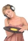 Fêmea DJ que risca o registro fotografia de stock royalty free