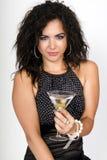 Fêmea do tempo do partido que prende um cocktail de martini Imagem de Stock