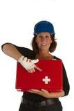 A fêmea ferida mostra o jogo de primeiros socorros imagem de stock royalty free