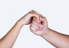 A fêmea masculina entrega o aperto de mão isolado no branco Imagens de Stock