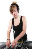 Fêmea nova DJ que joga a música Imagens de Stock