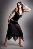 Fêmea nova no vestido preto Imagem de Stock Royalty Free
