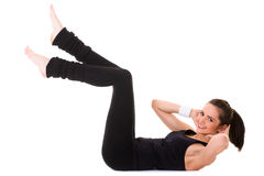 Fêmea nova que faz alguns exercícios no assoalho branco foto de stock royalty free