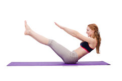 Fêmea nova que faz exercícios Fotos de Stock