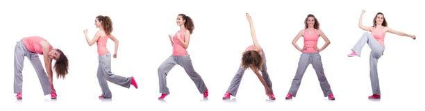 A fêmea nova que faz exercícios no branco imagem de stock