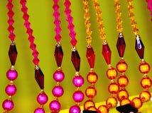 A fêmea ornaments a fotografia colorida do fundo Fotografia de Stock Royalty Free