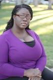 Fêmea preta nova no parque Fotografia de Stock Royalty Free