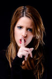 Fêmea que instrui para ser silencioso Foto de Stock Royalty Free