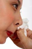 Fêmea que limpa seu nariz Imagens de Stock Royalty Free
