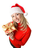 Fêmea que prende um presente de Natal imagens de stock royalty free
