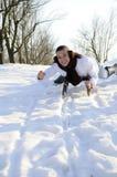 Fêmea que tem o divertimento no sledge Imagem de Stock Royalty Free