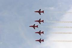 Fête aérienne rouge de flèches photo libre de droits