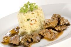 Fígado e arroz de galinha com aç6frão Fotografia de Stock